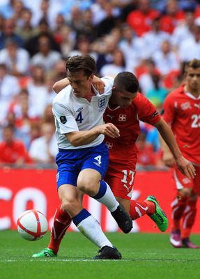LONDON, ENGLAND - JUNE 04:  Scott Parker of England (L) vies for the ball with Granit Xhaka of Switzerland during the UEFA EURO 2012 group G qualifying match between England and Switzerland at Wembley Stadium on June 4, 2011 in London, England.  (Photo by