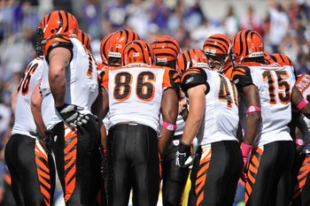 BALTIMORE - OCTOBER 11:  The Cincinnati Bengals offense huddles during the game against the Baltimore Ravens at M&T Bank Stadium on October 11, 2009 in Baltimore, Maryland. The Bengals defeated the Ravens 17-14. (Photo by Larry French/Getty Images)