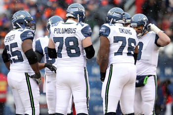 CHICAGO, IL - JANUARY 16:  (R) Quarterback Matt Hasselbeck #8 of the Seattle Seahawks huddles with Russell Okung #76, Tyler Polumbus #78 and other members of the Seahawks offensive line against the Chicago Bears in the 2011 NFC divisional playoff game at