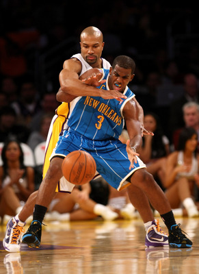 LOS ANGELES - NOVEMBER 8: Chris Paul #3 of the New Orleans Hornets tries to catch a pass as Derek Fisher #3 of the Los Angeles Lakers defends on November 8, 2009 at Staples Center in Los Angeles, California. The Lakers won 104-88.  NOTE TO USER: User expr