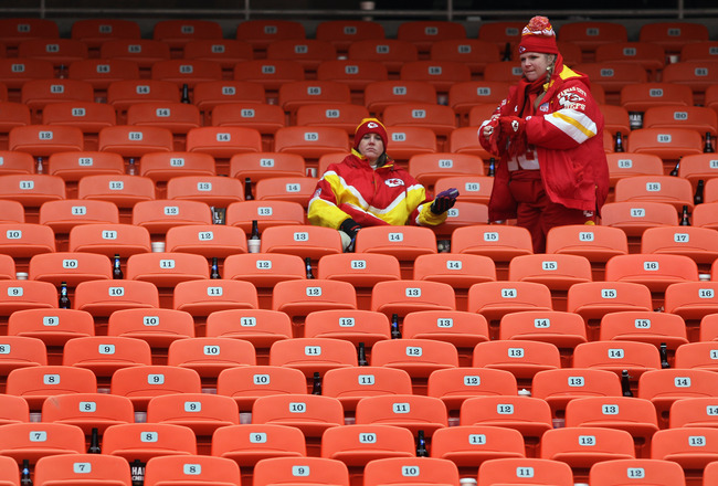 KANSAS CITY, MO - JANUARY 09:  Fans of the Kansas City Chiefs sit in the stands after the Baltimore Ravens defeated the Chiefs 30-7 in the 2011 AFC wild card playoff game at Arrowhead Stadium on January 9, 2011 in Kansas City, Missouri.  (Photo by Doug Pe