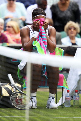 LONDON, ENGLAND - JUNE 21:  Serena Williams of the United States shows her emotions after winning her first round match against Aravane Rezai of France on Day Two of the Wimbledon Lawn Tennis Championships at the All England Lawn Tennis and Croquet Club o