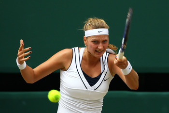 LONDON, ENGLAND - JULY 02:  Petra Kvitova of the Czech Republic returns a shot during her Ladies' final round match against Maria Sharapova of Russia on Day Twelve of the Wimbledon Lawn Tennis Championships at the All England Lawn Tennis and Croquet Club