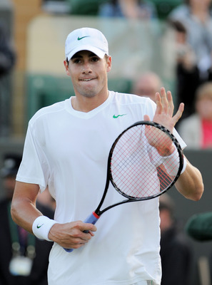 LONDON, ENGLAND - JUNE 21:  John Isner of the United States celebrates after winning his first round match against Nicolas Mahut of France on Day Two of the Wimbledon Lawn Tennis Championships at the All England Lawn Tennis and Croquet Club on June 21, 20