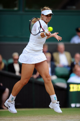 LONDON, ENGLAND - JUNE 30:  Sabine Lisicki of Germany returns a shot during her semifinal round match against Maria Sharapova of Russia on Day Ten of the Wimbledon Lawn Tennis Championships at the All England Lawn Tennis and Croquet Club on June 30, 2011