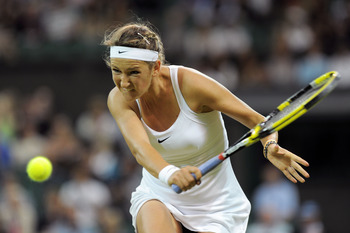 LONDON, ENGLAND - JUNE 28:  Victoria Azarenka of Belarus returns a shot during her quarterfinal round match against Tamira Paszek of Austria on Day Eight of the Wimbledon Lawn Tennis Championships at the All England Lawn Tennis and Croquet Club on June 28