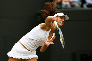 LONDON, ENGLAND - JUNE 28:  Tsvetana Pironkova of Bulgaria serves during her quarterfinal round match against Petra Kvitova of the Czech Republic on Day Eight of the Wimbledon Lawn Tennis Championships at the All England Lawn Tennis and Croquet Club on Ju