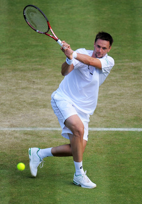 LONDON, ENGLAND - JUNE 25:  Robin Soderling of Sweden returns a shot during his third round match against Bernard Tomic of Australia on Day Six of the Wimbledon Lawn Tennis Championships at the All England Lawn Tennis and Croquet Club on June 25, 2011 in
