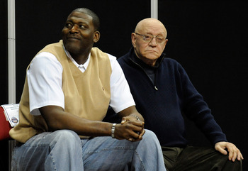 LAS VEGAS - MARCH 13:  Former UNLV Rebels head coach Jerry Tarkanian (R) and former NBA player Larry Johnson, one of Tarkanian's former Rebel players, appear during the championship game of the Conoco Mountain West Conference Basketball tournament between