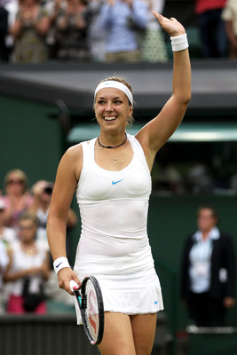 LONDON, ENGLAND - JUNE 28:  Sabine Lisicki of Germany waves to the crowd after winning her quarterfinal round match against Marion Bartoli of France on Day Eight of the Wimbledon Lawn Tennis Championships at the All England Lawn Tennis and Croquet Club on