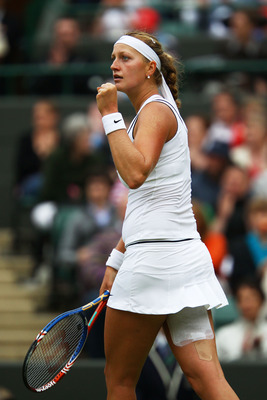 LONDON, ENGLAND - JUNE 28:  Petra Kvitova of the Czech Republic reacts to a play during her quarterfinal round match against Tsvetana Pironkova of Bulgaria on Day Eight of the Wimbledon Lawn Tennis Championships at the All England Lawn Tennis and Croquet