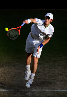 LONDON, ENGLAND - JUNE 29:  Andy Murray of Great Britain serves during his quarterfinal round match against Feliciano Lopez of Spain on Day Nine of the Wimbledon Lawn Tennis Championships at the All England Lawn Tennis and Croquet Club on June 29, 2011 in