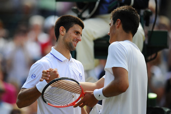 LONDON, ENGLAND - JUNE 29:  Novak Djokovic of Serbia (L) shakes hands with Bernard Tomic of Australia after winning his quarterfinal round match  on Day Nine of the Wimbledon Lawn Tennis Championships at the All England Lawn Tennis and Croquet Club on Jun