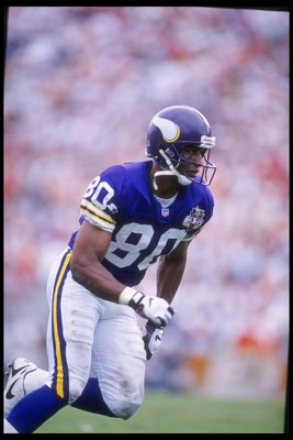 15 Oct 1995: Wide receiver Cris Carter of the Minnesota Vikings moves down the field during a game against the Tampa Bay Buccaneers at Tampa Stadium in Tampa, Florida. The Buccaneers won the game, 20-17.