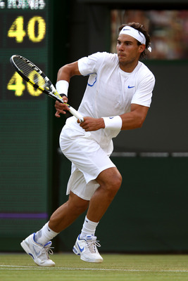 LONDON, ENGLAND - JUNE 29:  Rafael Nadal of Spain in action during his quaterfinal round match against  Mardy Fish of the United States on Day Nine of the Wimbledon Lawn Tennis Championships at the All England Lawn Tennis and Croquet Club on June 29, 2011