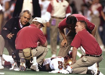 9 Jan 1999: Garrison Hearst #20 of the San Francisco 49ers lays on the field with a broken leg during the NFC Play Offs against the  Atlanta Falcons at the Georgia Dome in Atlanta, Georgia. The Falcons defeated the 49ers 20-16. Mandatory Credit: Craig Jon