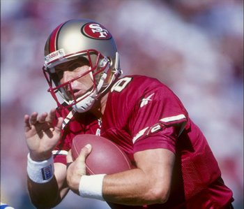 18 Oct 1998:  Quarterback Steve Young #8 of the San Francisco 49ers grips the ball as he is sacked  during the game against the Indianapolis Colts at 3Com Park in San Francisco, California.  The 49ers defeated the Colts 34-31. Mandatory Credit: Jed Jacobs