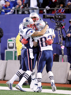 EAST RUTHERFORD, NJ - DECEMBER 29:  Randy Moss  #81 (center) of the New England Patriots celebrates with teammates Jabar Gaffney #10 and Wes Welker #83 after a catch for his 23rd touchdown of the season breaking the all time season high for touchdowns in