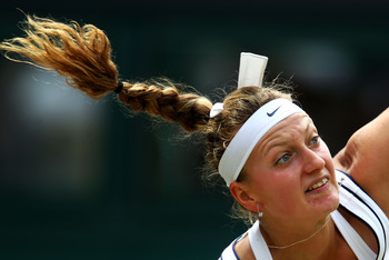 LONDON, ENGLAND - JUNE 30:  Petra Kvitova of the Czech Republic in action during her Women's semifinal match against  Victoria Azarenka of Belarus on Day Ten of the Wimbledon Lawn Tennis Championships at the All England Lawn Tennis and Croquet Club on Jun