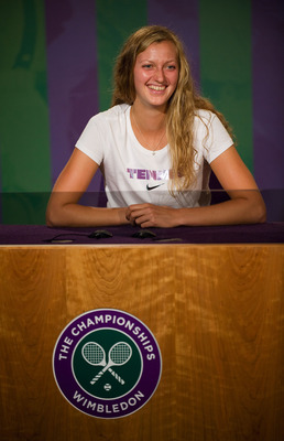 LONDON, ENGLAND - JULY 02:  Petra Kvitova of the Czech Republic attends a press conference after winning the Women's final against Maria Sharapova of Russia on Day Twelve of the Wimbledon Lawn Tennis Championships at the All England Lawn Tennis and Croque