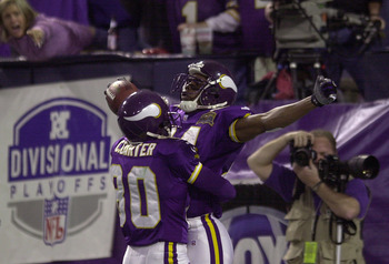 6 Jan 2001: Randy Moss #84 of the Minnesota Vikings celebrates his touchdown with Cris Carter #80 during the third quarter against the New Orleans Saints at the Hubert H. Humphrey Metrodome in Minneapolis, Minnesota. The Minnesota Vikings beat the New Orl