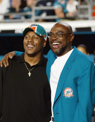 MIAMI - DECEMBER 15: (L-R) Newly inducted members of the Dolphins' Hall Of Fame, Mark Clayton #83, and Mark Duper #85, share a laugh as they hang out on the sideline during the Miami Dolphins game against the Philadelphia Eagles on December 15, 2003 at Pr