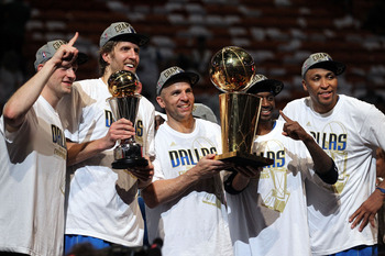 MIAMI, FL - JUNE 12:  (L-R) Brian Cardinal #35, Finals MVP Dirk Nowitzki #41, Jason Kidd #2, Jason Terry #31 and Shawn Marion #0 of the Dallas Mavericks celebrate with the Larry O'Brien Championship trophy after their 105-95 win against the Miami Heat in