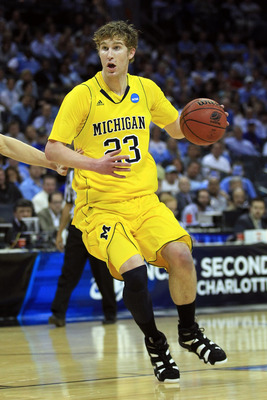 CHARLOTTE, NC - MARCH 20:  Evan Smotrycz #23 of the Michigan Wolverines moves the ball while taking on the Duke Blue Devils during the third round of the 2011 NCAA men's basketball tournament at Time Warner Cable Arena on March 20, 2011 in Charlotte, Nort