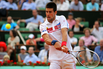 PARIS, FRANCE - JUNE 03:  Novak Djokovic of Serbia hits a backhand during the men's singles semi final match between Roger Federer of Switzerland and Novak Djokovic of Serbia on day thirteen of the French Open at Roland Garros on June 3, 2011 in Paris, Fr