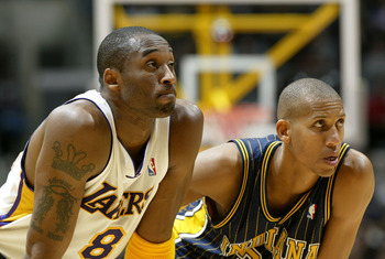 LOS ANGELES - NOVEMBER 30:  Kobe Bryant #8 of the Los Angeles Lakers and Reggie Miller #31 of the Indiana Pacers watch the action in the first half of the game on November 30, 2003 at Staples Center in Los Angeles, California.  NOTE TO USER: User expressl