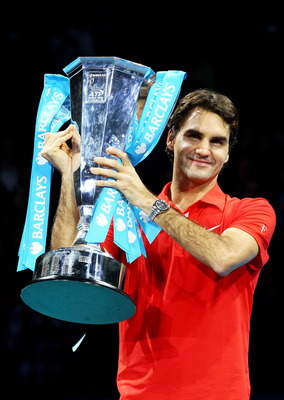 LONDON, ENGLAND - NOVEMBER 28:  Roger Federer of Switzerland poses with the trophy after defeating Rafael Nadal of Spain in their men's final match during the ATP World Tour Finals at O2 Arena on November 28, 2010 in London, England.  (Photo by Julian Fin