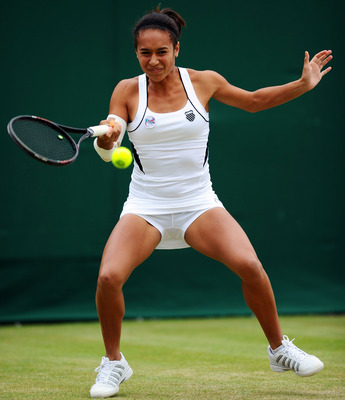 LONDON, ENGLAND - JUNE 25: Heather Watson of Great Britain returns a shot while playing with Jocelyn Rae of of Great Britain during their doubles match against Sophie Lefevre of France and   Evgeniya Rodina of Russia on Day Six of the Wimbledon Lawn Tenni