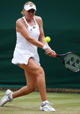 LONDON, ENGLAND - JUNE 24:  Elena Baltacha of Great Britain lines up a shot during her second round match against Shuai Peng of China on Day Five of the Wimbledon Lawn Tennis Championships at the All England Lawn Tennis and Croquet Club on June 24, 2011 i