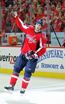 WASHINGTON , DC - APRIL 23:  Brooks Laich #21 of the Washington Capitals celebrates being named the third star of the game against the New York Rangers in Game Five of the Eastern Conference Quarterfinals during the 2011 NHL Stanley Cup Playoffs at the Ve
