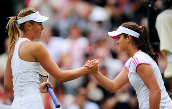LONDON, ENGLAND - JUNE 24:  Maria Sharapova of Russia shakes hands with Laura Robson of Great Britain after winning her second round match on Day Five of the Wimbledon Lawn Tennis Championships at the All England Lawn Tennis and Croquet Club on June 24, 2