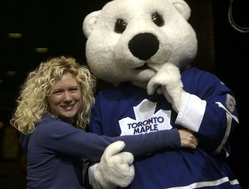 TORONTO - FEBRUARY 11:  Toronto Maple Leafs fan Melissa Lambert gives Maple Leafs bashful mascot Carlton the Bear a hug during the Maple Leafs game against the New York Rangers at the Air Canada Centre February 11, 2006 in Toronto, Ontario, Canada. The Ra