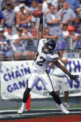 10 Sep 2000:  Jimmy Smith #82 of the Jacksonville Jaguars starts to spike the ball in celebration after running a touchdown during the game against the Baltimore Ravens at Psinet Stadium in Baltimore, Maryland.  The Ravens defeated the Jaguars 39-36. Mand