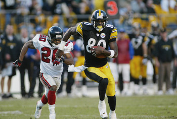 PITTSBURGH, PA - NOVEMBER 10:  Receiver Plaxico Burress #80 of the Pittsburgh Steelers breakks away from defender Allen Rossum #20 of the Atlanta Falcons on November 10, 2002 at Heinz Field in Pittsburgh, Pennsylvania. The game ended in a 34-34 tie. (Phot