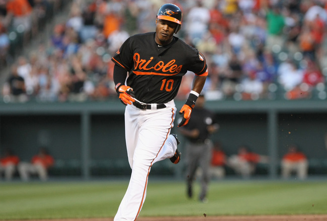 BALTIMORE, MD - JUNE 24: Adam Jones #10 of the Baltimore Orioles rounds the bases after hitting a home run against the Cincinnati Reds at Oriole Park at Camden Yards on June 24, 2011 in Baltimore, Maryland.  (Photo by Rob Carr/Getty Images)