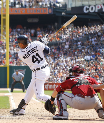 DETROIT - JUNE 26: Victor Martinez #41 of the Detroit Tigers singles to deep center field scoring Magglio Ordonez #30 in the eight inning of the game against the Arizona Diamondbacks at Comerica Park on June 26, 2011 in Detroit, Michigan. The Tigers defea