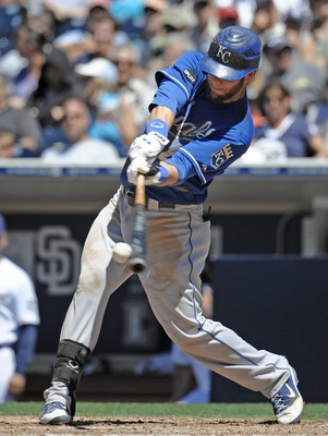 SAN DIEGO, CA - JUNE 29: Alex Gordon #4 of the Kansas City Royals connects for a sinlge during the eighth inning of a baseball game against the San Diego Padres at Petco Park on June 29, 2011 in San Diego, California.  (Photo by Denis Poroy/Getty Images)