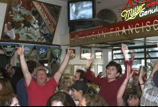 29 Jan 1995:  San Francisco 49ers fans cheer while watching Super Bowl XXIX against the San Diego Chargers at Pat O'Shea's Mad Hatter Bar in San Francisco, California.  The 49ers won the game, 49-26. Mandatory Credit: Otto Greule Jr.  /Allsport