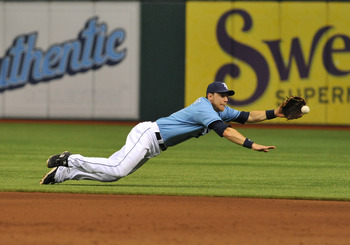 ST. PETERSBURG, FL - JULY 3:  Infielder Ben Zobrist #18 of the Tampa Bay Rays dives for a ground ball against the St. Louis Cardinals July 3, 2011 at Tropicana Field in St. Petersburg, Florida.  Zobrist threw the runner out and the Rays won 8 - 3. (Photo