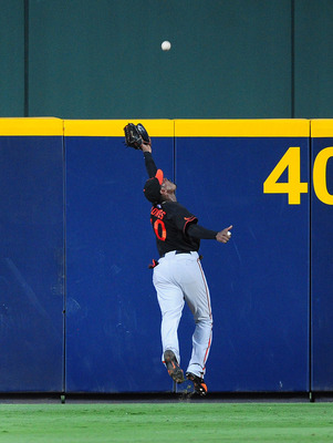 ATLANTA - JULY 1: Adam Jones #10 of the Baltimore Orioles makes a catch against the Atlanta Braves at Turner Field on July 1, 2011 in Atlanta, Georgia. (Photo by Scott Cunningham/Getty Images)