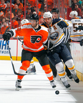 PHILADELPHIA, PA - APRIL 16:  Paul Gaustad #28 of the Buffalo Sabres is slowed down by Ville Leino #22 of the Philadelphia Flyers in Game Two of the Eastern Conference Quarterfinals during the 2011 NHL Stanley Cup Playoffs at Wells Fargo Center on April 1
