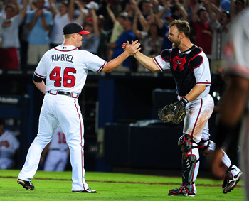 ATLANTA - JULY 2: Craig Kimbrel #46 and David Ross #8 of the Atlanta Braves celebrate after the game against the Baltimore Orioles at Turner Field on July 2, 2011 in Atlanta, Georgia. (Photo by Scott Cunningham/Getty Images)