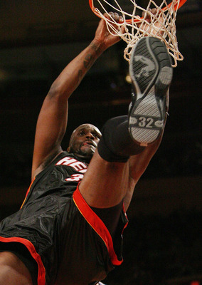 NEW YORK - JANUARY 26:  Shaquille O'Neal #32 of the Miami Heat dunks against the New York Knicks January 26, 2007 at Madison Square Garden in New York City. NOTE TO USER: User expressly acknowledges and agrees that, by downloading and or using this Photog