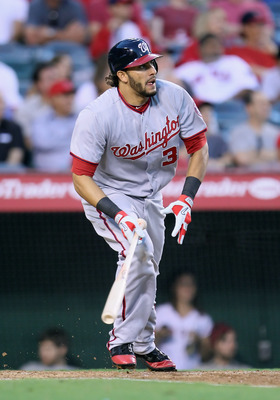 ANAHEIM, CA - JUNE 27:  Michael Morse #38 of the Washington Nationals hits a double against the Los Angeles Angels of Anaheim in the fourth inning at Angel Stadium of Anaheim on June 27, 2011 in Anaheim, California.  (Photo by Jeff Gross/Getty Images)