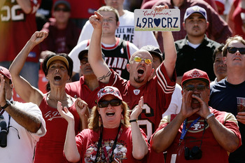SAN FRANCISCO - SEPTEMBER 20:  San Francisco 49er fans cheer during the home opener as the San Francisco 49ers host the Seattle Seahawks at Candlestick Park September 20, 2009 in San Francisco, California.  (Photo by David Paul Morris/Getty Images)
