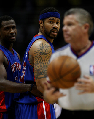 MILWAUKEE - FEBRUARY 07: Rasheed Wallace #30 of the Detroit Pistons has words with an official as teammate Antonio McDyess #24 holds him back during a game against the Milwaukee Bucks on February 7, 2009 at the Bradley Center in Milwaukee, Wisconsin. The